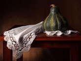 bodegón de paño y calabaza verde