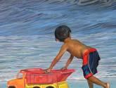 niño en la playa de reta