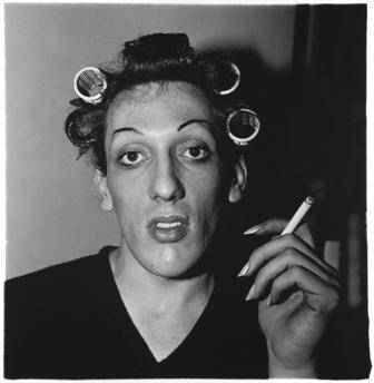 A young man in curlers at home on West 20th Street, N.Y.C., 1966 Copyright © The Estate of Diane Arbus