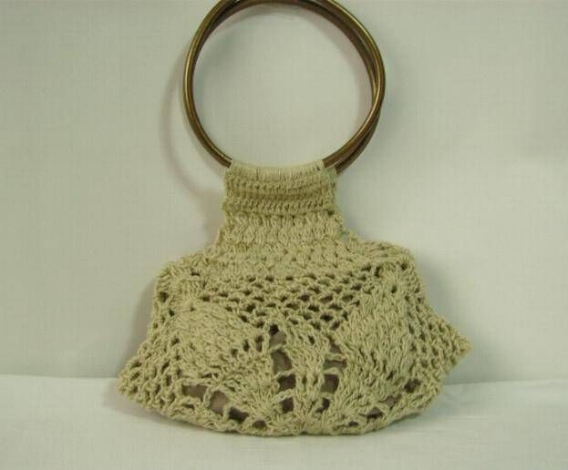 bolso tejido a crochet con asas color oro indumentaria tradicional