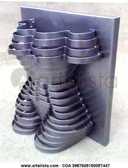Modelo Plata. Metal Figurativa