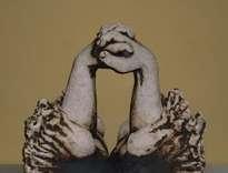 «a dos manos»