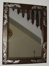 espejo  de  cuero repujado  recamado en plata.