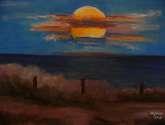 luna llena sobre el mar