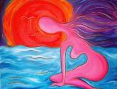 figura de mujer junto al mar a la puesta del sol