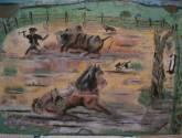 lidiando con ganado en el corral