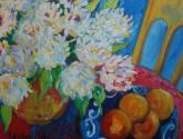 bodegon con flores y naranjas